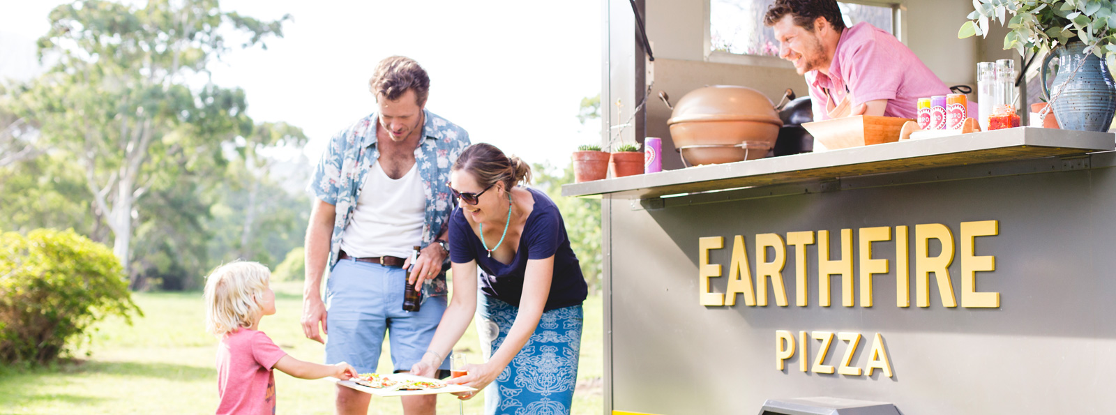 EarthFire Pizza Food Truck - Family eating